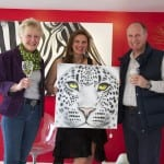 Suzanne and Jerry Wickham with their Snow Leopard