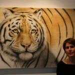 16 Charlotte Corney in front of the painting of her tiger Zia