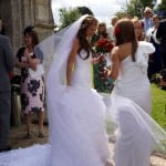 7 Greeting her wedding guests outside the church